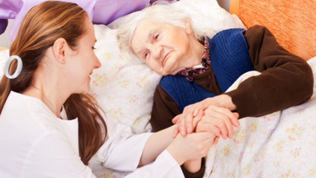 Fotolia 46721679 - Young doctor holds the elderly woman hands © Ocskay Bence